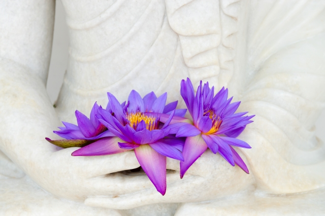 bigstock-Fresh-Flowers-In-Buddha-Image--45921412